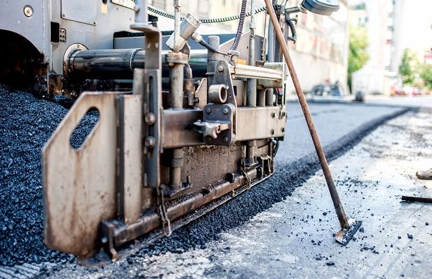 close up of asphalting machinery and tools working at industrial