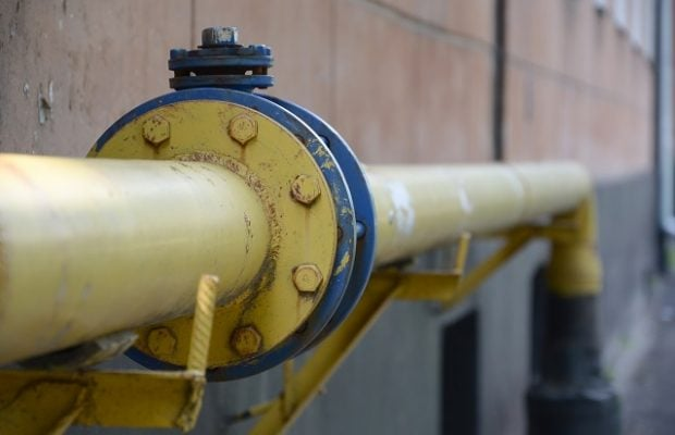 yellow gas pipe in front of residential building wall