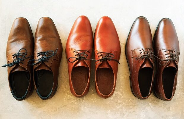 men shoes collection different models and brown colors. top view. sale and shopping concept