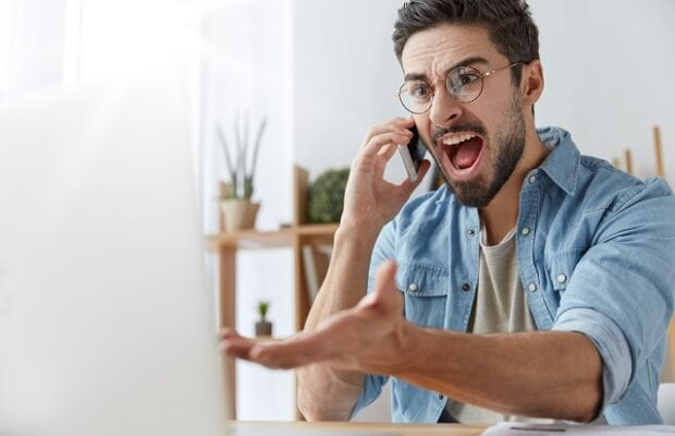 mad executive manager has quarrel with employee over cell phone, dissatisfied with bad report and failure. irritated furious male angry with software bugs in application, can`t continue work