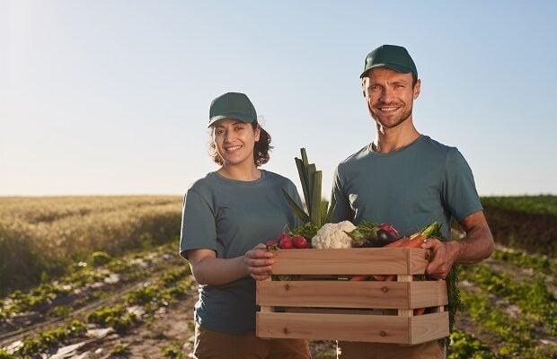 proud farmers at plantation
