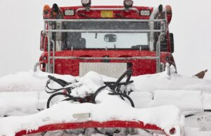 snow blower truck covered by snow. winter time. snowing