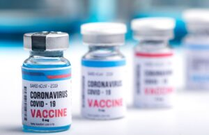 virus vaccine development of a coronavirus covid 19, vaccine bottle in concept of insurance and fight against coronavirus 2019 ncov cure, medical research in laboratory to stop the spread of the virus
